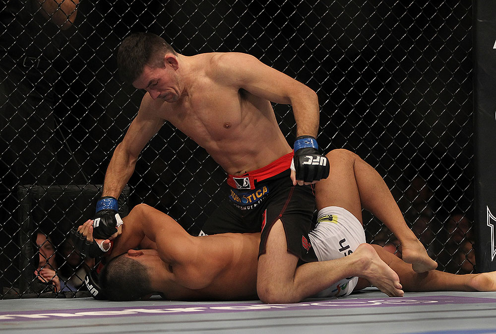 LAS VEGAS, NV - JULY 7:   Demian Maia (top) punches Dong Hyun Kim during their welterweight bout at UFC 148 inside MGM Grand Garden Arena on July 7, 2012 in Las Vegas, Nevada.  (Photo by Josh Hedges/Zuffa LLC/Zuffa LLC via Getty Images)  *** Local Caption *** Demian Maia; Dong Hyun Kim
