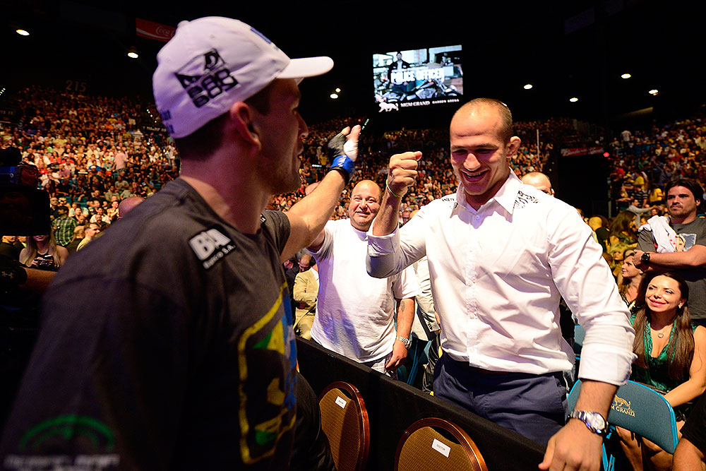 LAS VEGAS, NV - JULY 7:   (L-R) Demian Maia celebrates with Junior dos Santos after his fight with Dong Hyun Kim during UFC 148 inside MGM Grand Garden Arena on July 7, 2012 in Las Vegas, Nevada.  (Photo by Donald Miralle/Zuffa LLC/Zuffa LLC via Getty Images)  *** Local Caption *** Demian Maia