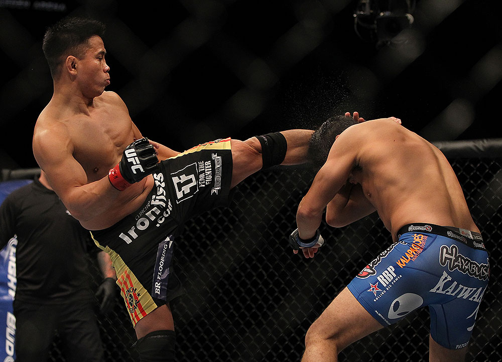 LAS VEGAS, NV - JULY 7:   (L-R) Cung Le kicks Patrick Cote during their middleweight bout at UFC 148 inside MGM Grand Garden Arena on July 7, 2012 in Las Vegas, Nevada.  (Photo by Josh Hedges/Zuffa LLC/Zuffa LLC via Getty Images)  *** Local Caption *** Cung Le; Patrick Cote
