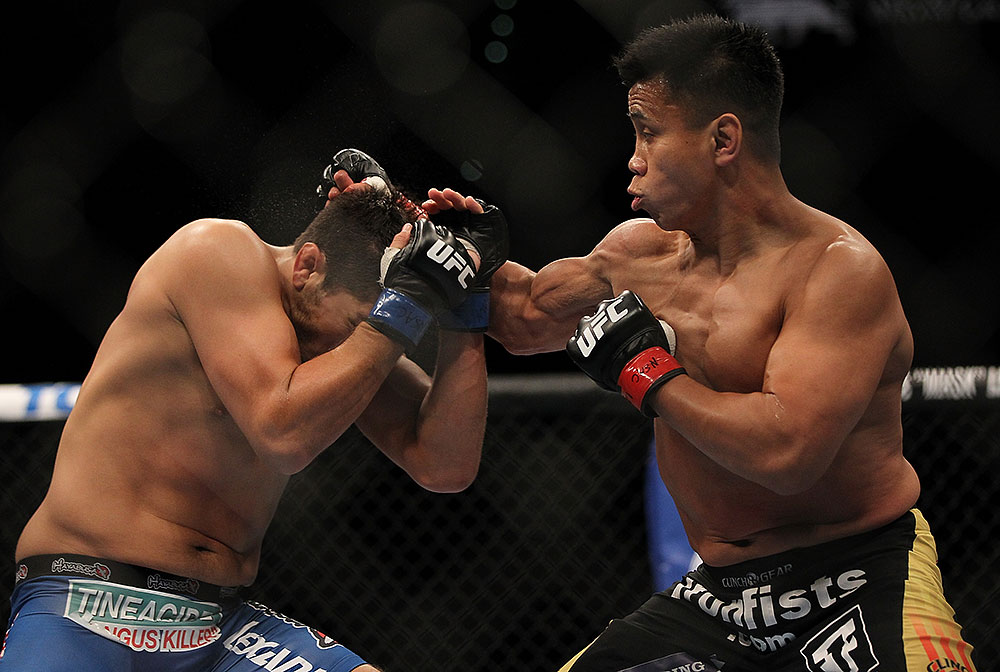 LAS VEGAS, NV - JULY 7:   (R-L) Cung Le punches Patrick Cote during their middleweight bout at UFC 148 inside MGM Grand Garden Arena on July 7, 2012 in Las Vegas, Nevada.  (Photo by Josh Hedges/Zuffa LLC/Zuffa LLC via Getty Images)  *** Local Caption *** Cung Le; Patrick Cote