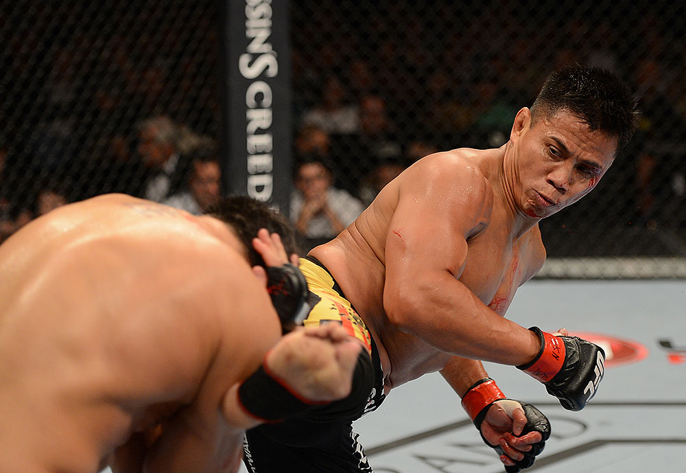 LAS VEGAS, NV - JULY 7:   Cung Le (right) kicks Patrick Cote during their middleweight bout at UFC 148 inside MGM Grand Garden Arena on July 7, 2012 in Las Vegas, Nevada.  (Photo by Donald Miralle/Zuffa LLC/Zuffa LLC via Getty Images)  *** Local Caption *** Cung Le; Patrick Cote