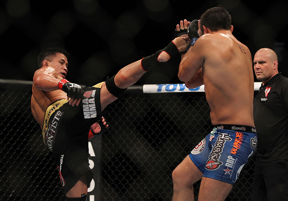 LAS VEGAS, NV - JULY 7:   Cung Le (left) kicks Patrick Cote during their middleweight bout at UFC 148 inside MGM Grand Garden Arena on July 7, 2012 in Las Vegas, Nevada.  (Photo by Josh Hedges/Zuffa LLC/Zuffa LLC via Getty Images)  *** Local Caption *** Cung Le; Patrick Cote