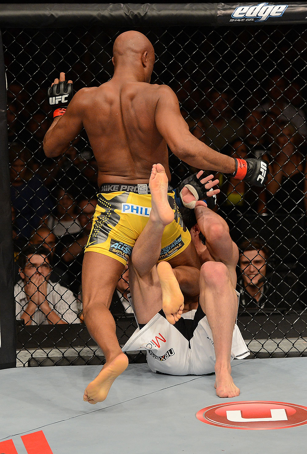 LAS VEGAS, NV - JULY 7:   (L-R) Anderson Silva hits Chael Sonnen with a knee during their UFC middleweight championship bout at UFC 148 inside MGM Grand Garden Arena on July 7, 2012 in Las Vegas, Nevada.  (Photo by Donald Miralle/Zuffa LLC/Zuffa LLC via Getty Images)  *** Local Caption *** Anderson Silva; Chael Sonnen