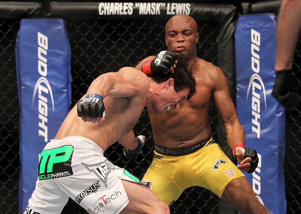 LAS VEGAS, NV - JULY 7:   Anderson Silva (right) punches Chael Sonnen during their UFC middleweight championship bout at UFC 148 inside MGM Grand Garden Arena on July 7, 2012 in Las Vegas, Nevada.  (Photo by Josh Hedges/Zuffa LLC/Zuffa LLC via Getty Images)  *** Local Caption *** Anderson Silva; Chael Sonnen