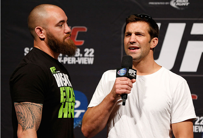LAS VEGAS, NV - FEBRUARY 21:  (R-L) UFC middleweight contender Luke Rockhold and heavyweight contender Travis Browne interact with fans during a Q&A session before the UFC 170 weigh-in event at the Mandalay Bay Events Center on February 21, 2014 in Las Vegas, Nevada. (Photo by Josh Hedges/Zuffa LLC/Zuffa LLC via Getty Images)