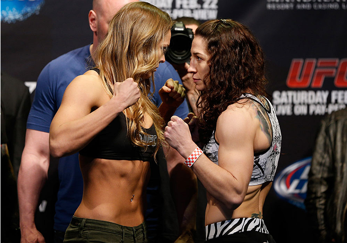 LAS VEGAS, NV - FEBRUARY 21:  (L-R) Opponents Ronda Rousey and Sara McMann face off during the UFC 170 weigh-in event at the Mandalay Bay Events Center on February 21, 2014 in Las Vegas, Nevada. (Photo by Josh Hedges/Zuffa LLC/Zuffa LLC via Getty Images)