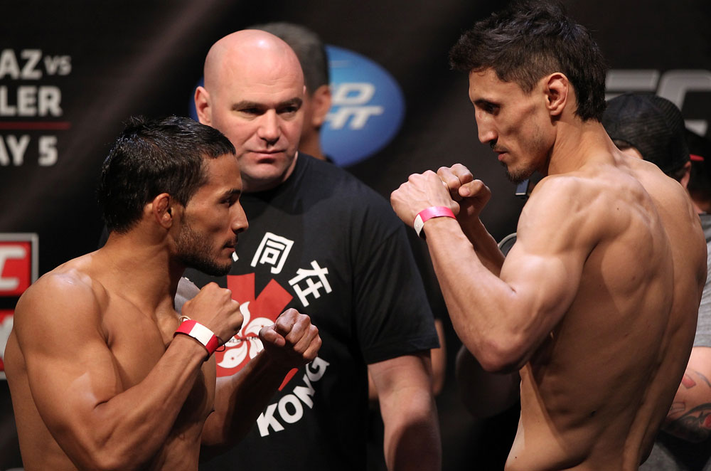 EAST RUTHERFORD, NJ - MAY 04:  (L-R) Featherweight opponents Dennis Bermudez and Pablo Garza face off after weighing in during the UFC on FOX official weigh in at Izod Center on May 4, 2012 in East Rutherford, New Jersey.  (Photo by Josh Hedges/Zuffa LLC/Zuffa LLC via Getty Images)