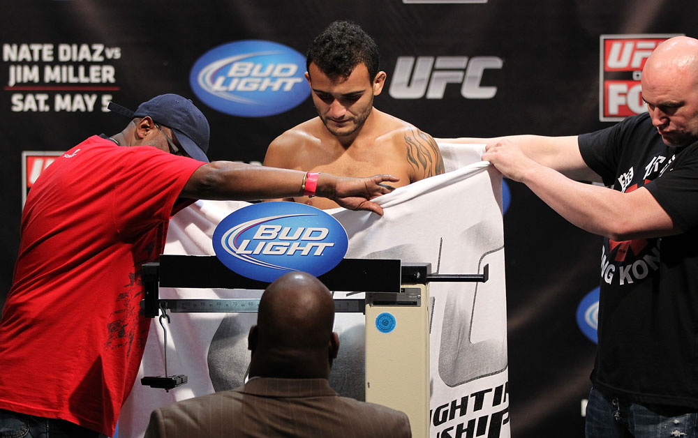 EAST RUTHERFORD, NJ - MAY 04:  John Lineker weighs in during the UFC on FOX official weigh in at Izod Center on May 4, 2012 in East Rutherford, New Jersey.  (Photo by Josh Hedges/Zuffa LLC/Zuffa LLC via Getty Images)