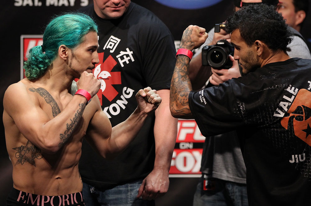 EAST RUTHERFORD, NJ - MAY 04:  (L-R) Flyweight opponents Louis Gaudinot and John Lineker face off during the UFC on FOX official weigh in at Izod Center on May 4, 2012 in East Rutherford, New Jersey.  (Photo by Josh Hedges/Zuffa LLC/Zuffa LLC via Getty Images)