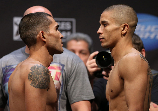 LOS ANGELES - AUGUST 03: (L-R) Opponents Ulysses Gomez and John Moraga face off during the UFC on FOX weigh in at Staples Center on August 3, 2012 in Los Angeles, California. (Photo by Josh Hedges/Zuffa LLC/Zuffa LLC via Getty Images)