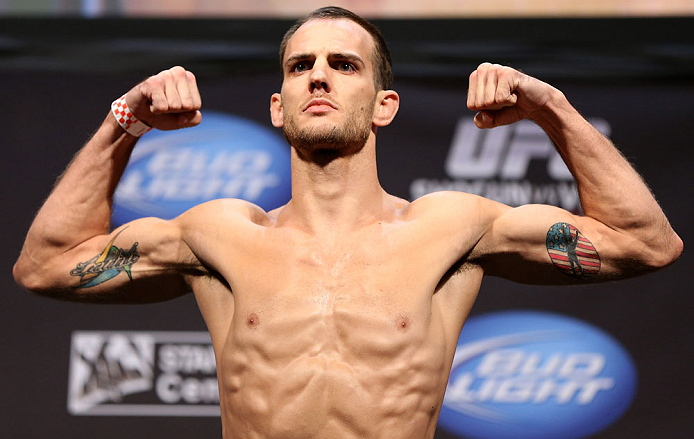 LOS ANGELES - AUGUST 03: Cole Miller makes weight during the UFC on FOX weigh in at Staples Center on August 3, 2012 in Los Angeles, California. (Photo by Josh Hedges/Zuffa LLC/Zuffa LLC via Getty Images)