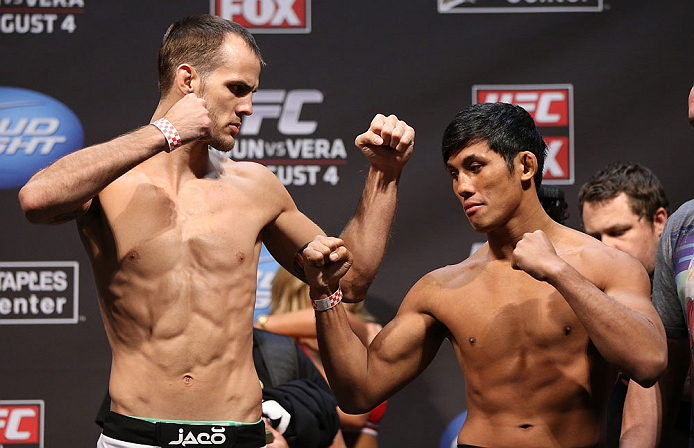 LOS ANGELES - AUGUST 03: (L-R) Opponents Cole Miller and Nam Phan face off during the UFC on FOX weigh in at Staples Center on August 3, 2012 in Los Angeles, California. (Photo by Josh Hedges/Zuffa LLC/Zuffa LLC via Getty Images)