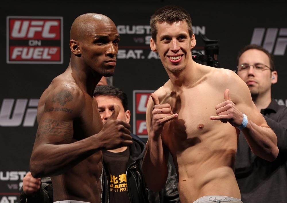 STOCKHOLM, SWEDEN - APRIL 13:  (L-R) Middleweight opponents Francis Carmont and Magnus Cedenblad face off after weighing in during the official UFC on Fuel TV weigh in event at Ericsson Globe on April 13, 2012 in Stockholm, Sweden.  (Photo by Josh Hedges/Zuffa LLC/Zuffa LLC via Getty Images)