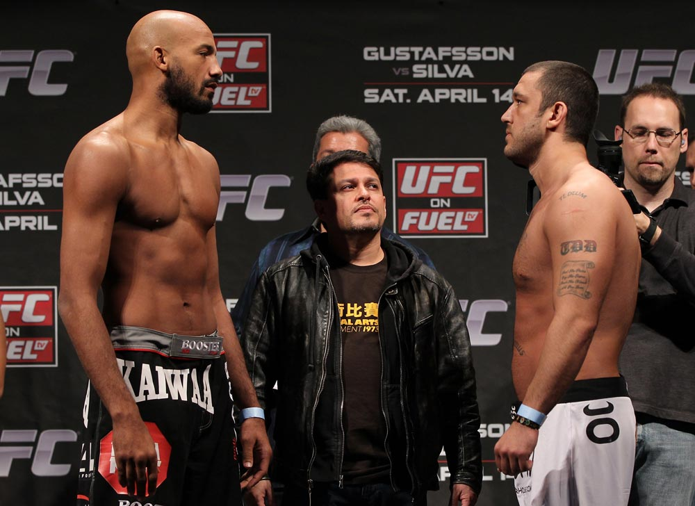 STOCKHOLM, SWEDEN - APRIL 13:  (L-R) Light heavyweight opponents Cyrille Diabate and Tom DeBlass face off after weighing in during the official UFC on Fuel TV weigh in event at Ericsson Globe on April 13, 2012 in Stockholm, Sweden.  (Photo by Josh Hedges/Zuffa LLC/Zuffa LLC via Getty Images)