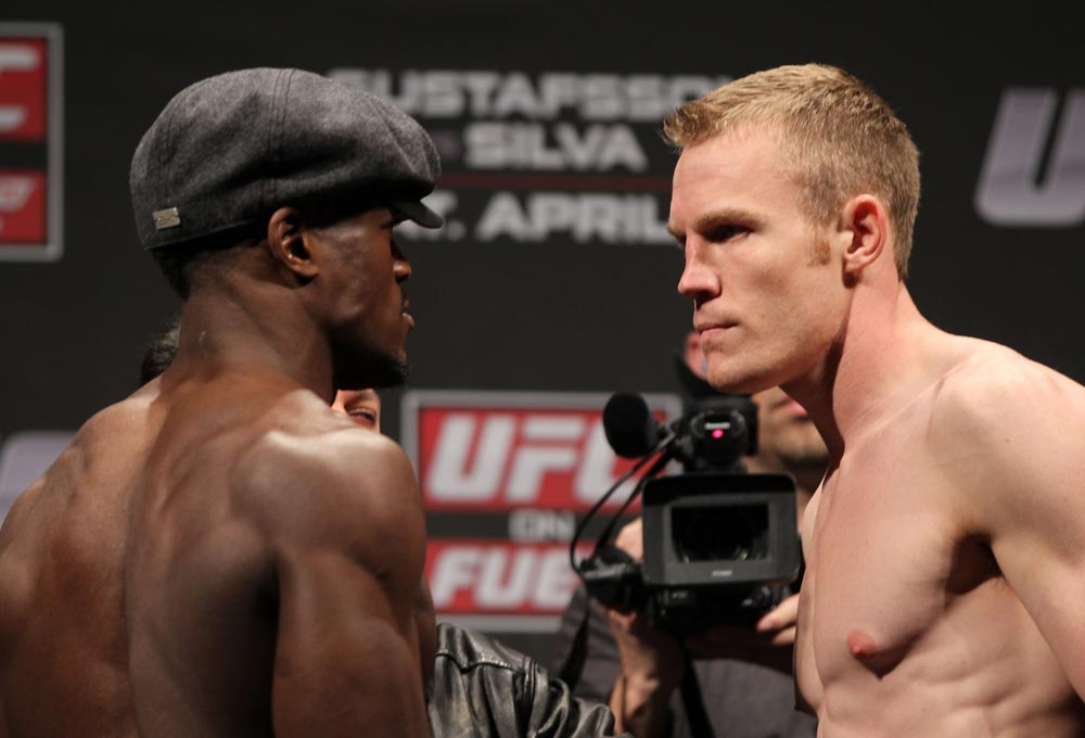 STOCKHOLM, SWEDEN - APRIL 13:  (L-R) Welterweight opponents Papy Abedi and James Head face off after weighing in during the official UFC on Fuel TV weigh in event at Ericsson Globe on April 13, 2012 in Stockholm, Sweden.  (Photo by Josh Hedges/Zuffa LLC/Zuffa LLC via Getty Images)