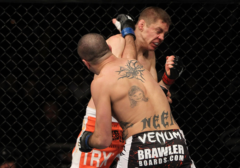 NASHVILLE, TN - JANUARY 20:  (L-R) Josh Neer punches Duane Ludwig during the UFC on FX event at Bridgestone Arena on January 20, 2012 in Nashville, Tennessee.  (Photo by Josh Hedges/Zuffa LLC/Zuffa LLC via Getty Images)