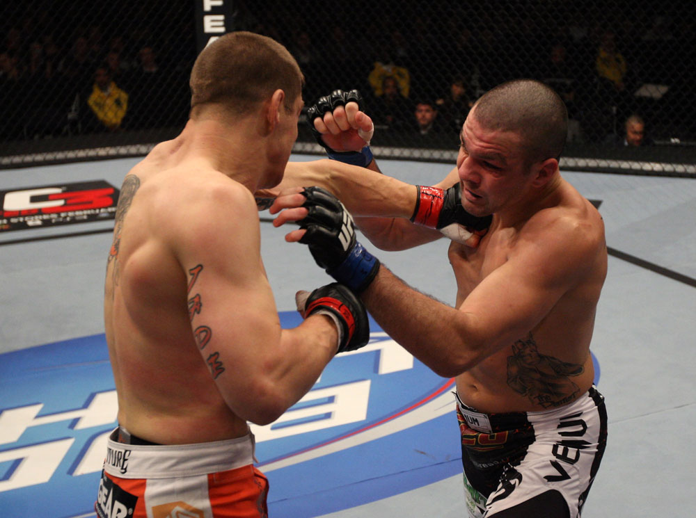 NASHVILLE, TN - JANUARY 20:  (L-R) Duane Ludwig punches Josh Neer during the UFC on FX event at Bridgestone Arena on January 20, 2012 in Nashville, Tennessee.  (Photo by Josh Hedges/Zuffa LLC/Zuffa LLC via Getty Images)