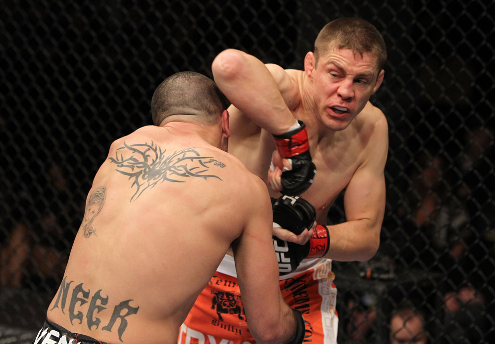 NASHVILLE, TN - JANUARY 20:  (R-L) Duane Ludwig delivers an elbow strike against Josh Neer during the UFC on FX event at Bridgestone Arena on January 20, 2012 in Nashville, Tennessee.  (Photo by Josh Hedges/Zuffa LLC/Zuffa LLC via Getty Images)