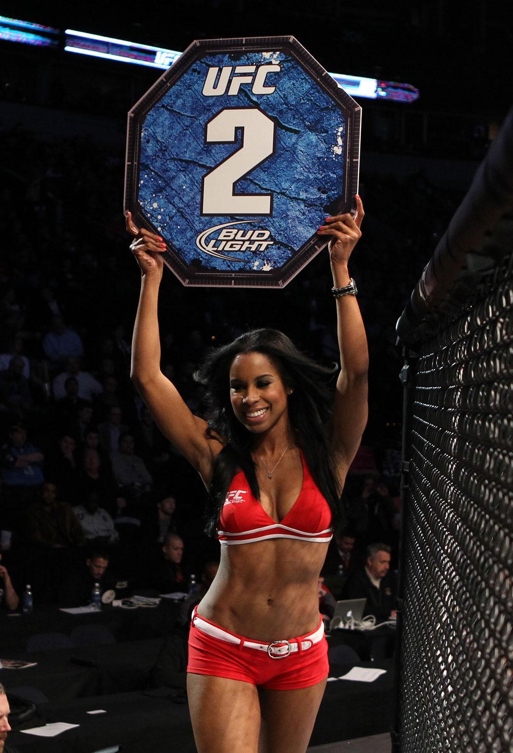 NASHVILLE, TN - JANUARY 20:  UFC Octagon Girl Chandella Powell introduces round two before the Brenneman vs Roberts bout during the UFC on FX event at Bridgestone Arena on January 20, 2012 in Nashville, Tennessee.  (Photo by Josh Hedges/Zuffa LLC/Zuffa LLC via Getty Images)