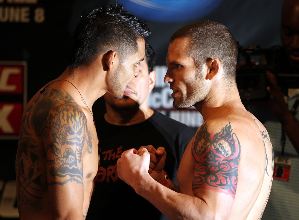 SUNRISE, FL - JUNE 07:   (L-R) Featherweight opponents Leonard Garcia and Matt Grice face off after making weight during the UFC on FX 3 official weigh in at Bank Atlantic Center on June 7, 2012 in Sunrise, Florida.  (Photo by Josh Hedges/Zuffa LLC/Zuffa LLC via Getty Images)