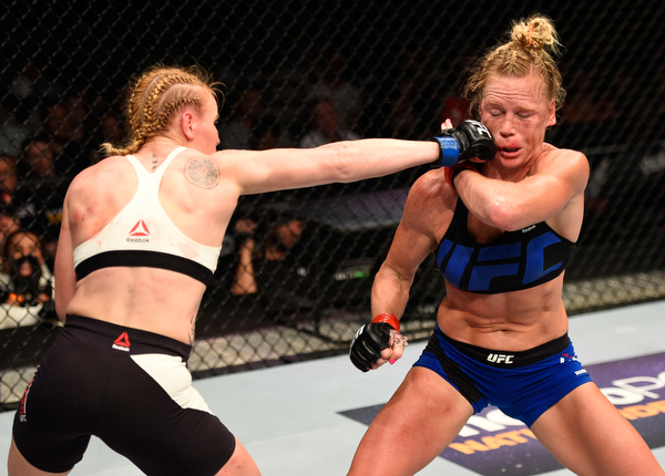 CHICAGO, IL - JULY 23: (L-R) Valentina Shevchenko of Kyrgyzstan punches Holly Holm in their women's bantamweight bout during the UFC Fight Night event at the United Center on July 23, 2016 in Chicago, Illinois. (Photo by Josh Hedges/Zuffa LLC/Zuffa LLC via Getty Images)