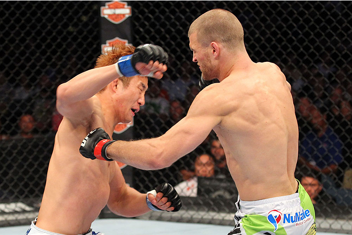 MILWAUKEE, WI - AUGUST 31:  (L-R) Hyun Gyu Lim punches Pascal Krauss in their UFC welterweight bout at BMO Harris Bradley Center on August 31, 2013 in Milwaukee, Wisconsin. (Photo by Ed Mulholland/Zuffa LLC/Zuffa LLC via Getty Images) *** Local Caption *** Pascal Krauss; Hyun Gyu Lim