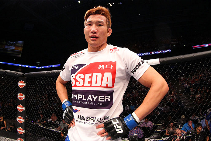MILWAUKEE, WI - AUGUST 31:  Hyun Gyu Lim celebrates after defeating Pascal Krauss in their UFC welterweight bout at BMO Harris Bradley Center on August 31, 2013 in Milwaukee, Wisconsin. (Photo by Ed Mulholland/Zuffa LLC/Zuffa LLC via Getty Images) *** Local Caption *** Hyun Gyu Lim