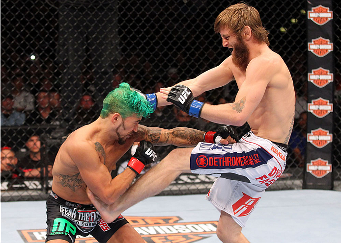 MILWAUKEE, WI - AUGUST 31:  (R-L) Tim Elliott kicks Louis Gaudinot in their UFC flyweight bout at BMO Harris Bradley Center on August 31, 2013 in Milwaukee, Wisconsin. (Photo by Ed Mulholland/Zuffa LLC/Zuffa LLC via Getty Images) *** Local Caption *** Louis Gaudinot; Tim Elliott