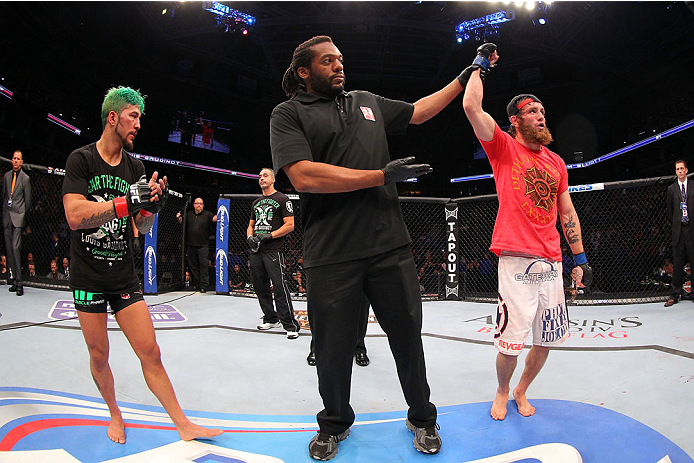 MILWAUKEE, WI - AUGUST 31:  (R-L)Tim Elliott celebrates after defeating Louis Gaudinot in their UFC flyweight bout at BMO Harris Bradley Center on August 31, 2013 in Milwaukee, Wisconsin. (Photo by Ed Mulholland/Zuffa LLC/Zuffa LLC via Getty Images) *** Local Caption *** Tim Elliott; Louis Gaudinot
