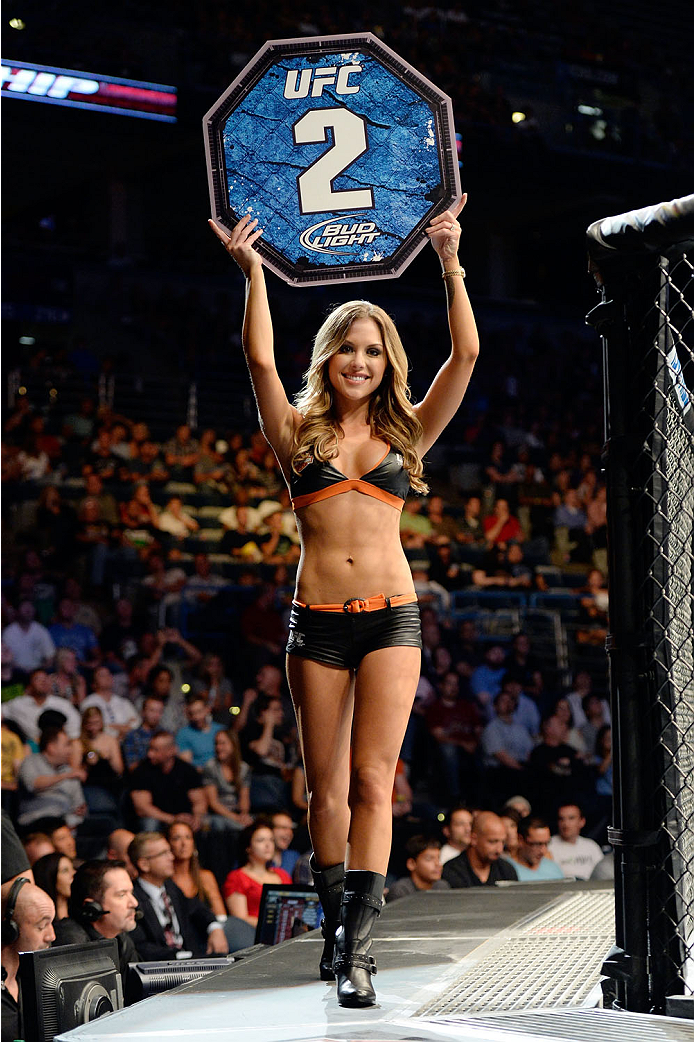 MILWAUKEE, WI - AUGUST 31:  UFC Octagon Girl Brittney Palmer introduces round two for the bout between Louis Gaudinot and Tim Elliott in their UFC flyweight bout at BMO Harris Bradley Center on August 31, 2013 in Milwaukee, Wisconsin. (Photo by Jeff Bottari/Zuffa LLC/Zuffa LLC via Getty Images) *** Local Caption *** Brittney Palmer