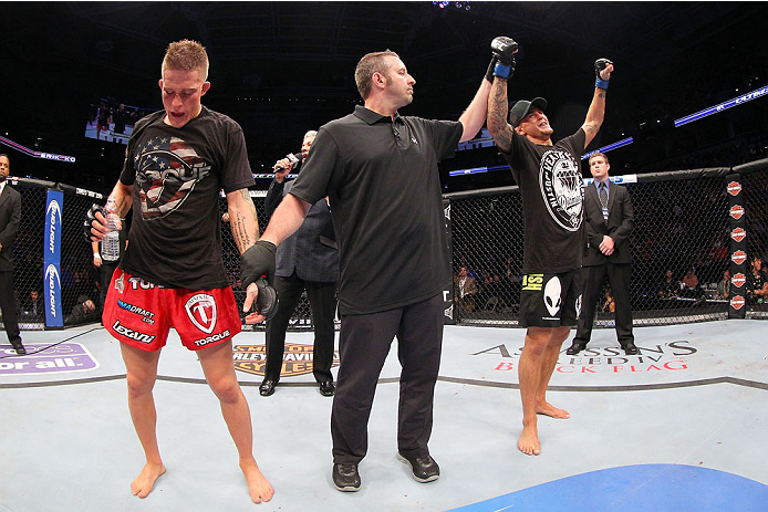 MILWAUKEE, WI - AUGUST 31:  (R-L) Dustin Poirier celebrates after defeating Erik Koch in their UFC featherweight bout at BMO Harris Bradley Center on August 31, 2013 in Milwaukee, Wisconsin. (Photo by Ed Mulholland/Zuffa LLC/Zuffa LLC via Getty Images) *** Local Caption *** Erik Koch; Dustin Poirier