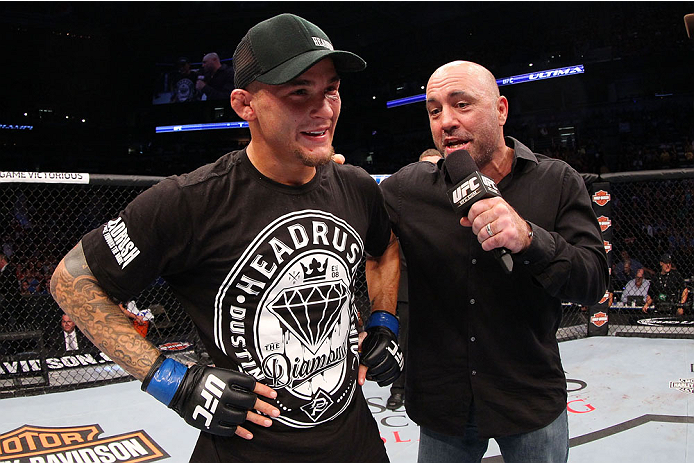 MILWAUKEE, WI - AUGUST 31:  Dustin Poirier speaks with Joe Rogan after defeating Erik Koch (not pictured) in their UFC featherweight bout at BMO Harris Bradley Center on August 31, 2013 in Milwaukee, Wisconsin. (Photo by Ed Mulholland/Zuffa LLC/Zuffa LLC via Getty Images) *** Local Caption *** Dustin Poirier; Joe Rogan