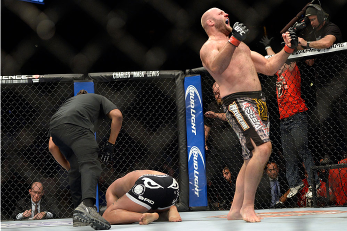 MILWAUKEE, WI - AUGUST 31:  (R-L) Ben Rothwell celebrates after defeating Brandon Vera by TKO in their UFC heavyweight bout at BMO Harris Bradley Center on August 31, 2013 in Milwaukee, Wisconsin. (Photo by Jeff Bottari/Zuffa LLC/Zuffa LLC via Getty Images) *** Local Caption *** Ben Rothwell; Brandon Vera