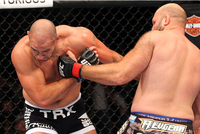 MILWAUKEE, WI - AUGUST 31:  (R-L) Ben Rothwell punches Brandon Vera in their UFC heavyweight bout at BMO Harris Bradley Center on August 31, 2013 in Milwaukee, Wisconsin. (Photo by Ed Mulholland/Zuffa LLC/Zuffa LLC via Getty Images) *** Local Caption *** Ben Rothwell; Brandon Vera