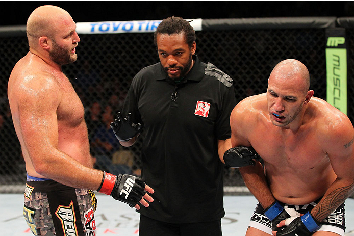 MILWAUKEE, WI - AUGUST 31:  Referee Herb Dean calls a stoppage due to Ben Rothwell (L) kicking Brandon Vera (R) below the belt in their UFC heavyweight bout at BMO Harris Bradley Center on August 31, 2013 in Milwaukee, Wisconsin. (Photo by Ed Mulholland/Zuffa LLC/Zuffa LLC via Getty Images) *** Local Caption *** Ben Rothwell; Brandon Vera; Herb Dean