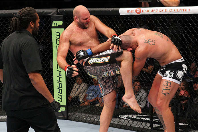 MILWAUKEE, WI - AUGUST 31:  (L-R) Ben Rothwell knees Brandon Vera in their UFC heavyweight bout at BMO Harris Bradley Center on August 31, 2013 in Milwaukee, Wisconsin. (Photo by Ed Mulholland/Zuffa LLC/Zuffa LLC via Getty Images) *** Local Caption *** Ben Rothwell; Brandon Vera