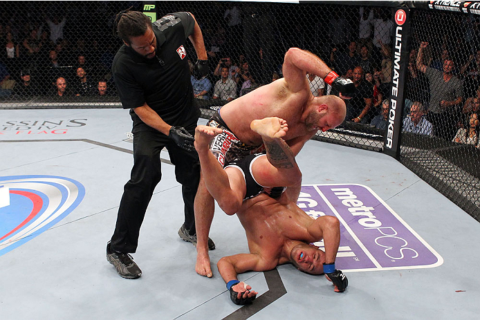MILWAUKEE, WI - AUGUST 31:  (L-R) Ben Rothwell punches Brandon Vera in their UFC heavyweight bout at BMO Harris Bradley Center on August 31, 2013 in Milwaukee, Wisconsin. (Photo by Ed Mulholland/Zuffa LLC/Zuffa LLC via Getty Images) *** Local Caption *** Ben Rothwell; Brandon Vera; Herb Dean