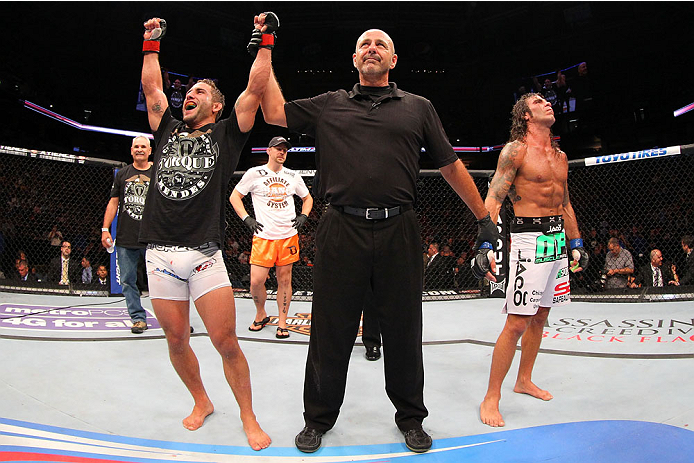 MILWAUKEE, WI - AUGUST 31:  (L-R) Chad Mendes celebrates after defeating Clay Guida in their UFC featherweight bout at BMO Harris Bradley Center on August 31, 2013 in Milwaukee, Wisconsin. (Photo by Ed Mulholland/Zuffa LLC/Zuffa LLC via Getty Images) *** Local Caption *** Chad Mendes; Clay Guida