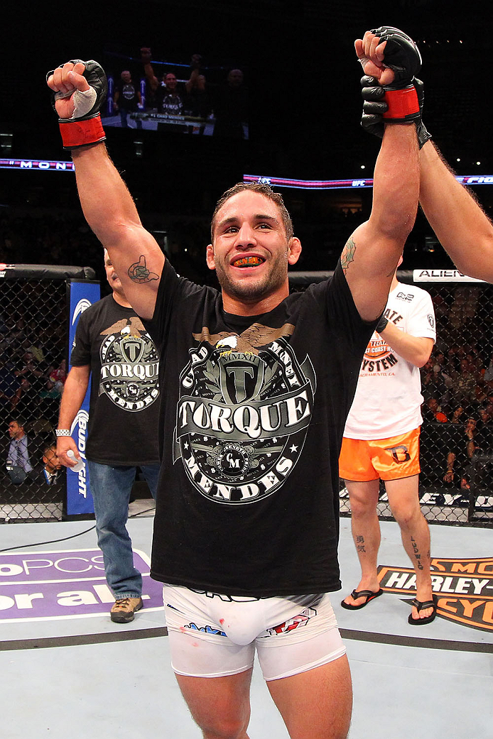 MILWAUKEE, WI - AUGUST 31:  Chad Mendes celebrates after defeating Clay Guida (not pictured) in their UFC featherweight bout at BMO Harris Bradley Center on August 31, 2013 in Milwaukee, Wisconsin. (Photo by Ed Mulholland/Zuffa LLC/Zuffa LLC via Getty Images) *** Local Caption *** Chad Mendes