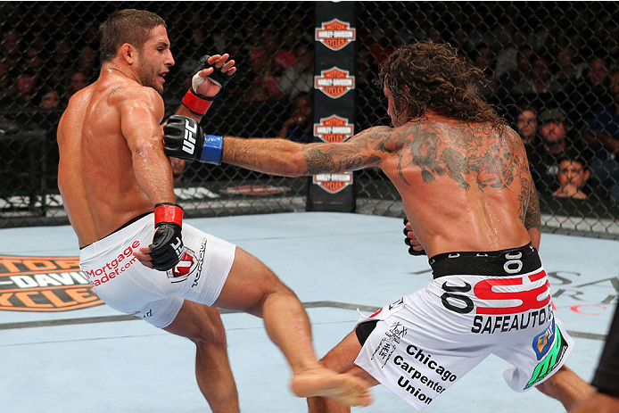 MILWAUKEE, WI - AUGUST 31:  (L-R) Chad Mendes kicks Clay Guida in their UFC featherweight bout at BMO Harris Bradley Center on August 31, 2013 in Milwaukee, Wisconsin. (Photo by Ed Mulholland/Zuffa LLC/Zuffa LLC via Getty Images) *** Local Caption *** Chad Mendes; Clay Guida