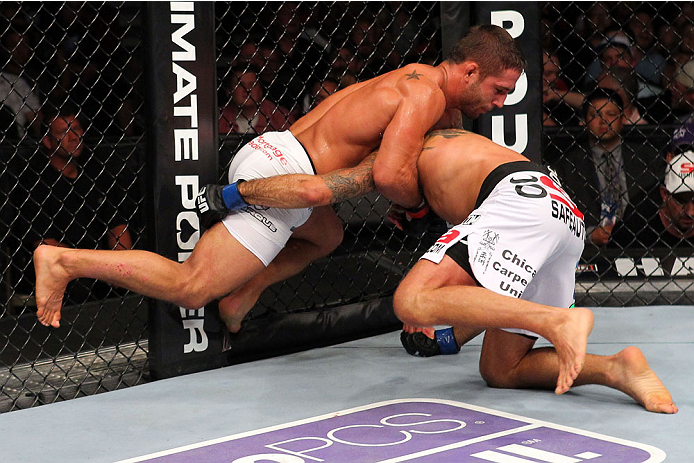 MILWAUKEE, WI - AUGUST 31:  (L-R) Chad Mendes uses the wall of the Octagon to get position against Clay Guida in their UFC featherweight bout at BMO Harris Bradley Center on August 31, 2013 in Milwaukee, Wisconsin. (Photo by Ed Mulholland/Zuffa LLC/Zuffa LLC via Getty Images) *** Local Caption *** Chad Mendes; Clay Guida