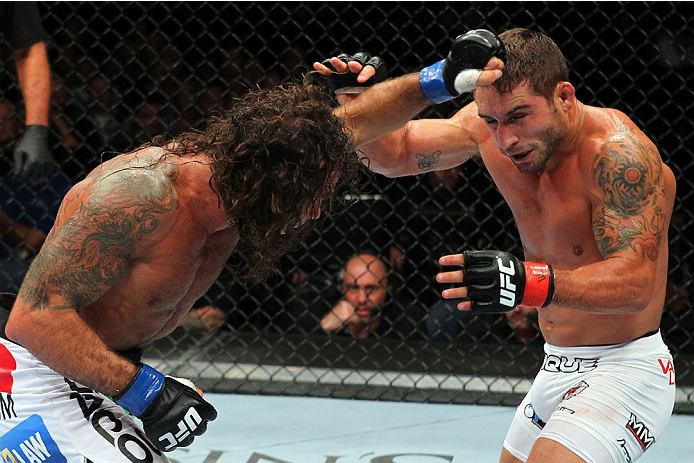 MILWAUKEE, WI - AUGUST 31:  (L-R) Clay Guida punches Chad Mendes in their UFC featherweight bout at BMO Harris Bradley Center on August 31, 2013 in Milwaukee, Wisconsin. (Photo by Ed Mulholland/Zuffa LLC/Zuffa LLC via Getty Images) *** Local Caption *** Chad Mendes; Clay Guida