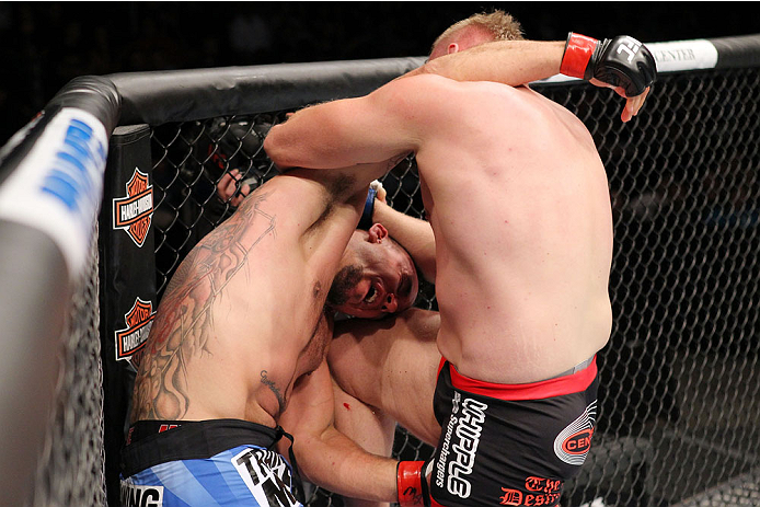 MILWAUKEE, WI - AUGUST 31:  (R-L) Josh Barnett puts a knee to the head of Frank Mir in their UFC heavyweight bout at BMO Harris Bradley Center on August 31, 2013 in Milwaukee, Wisconsin. (Photo by Ed Mulholland/Zuffa LLC/Zuffa LLC via Getty Images) *** Local Caption *** Frank Mir; Josh Barnett