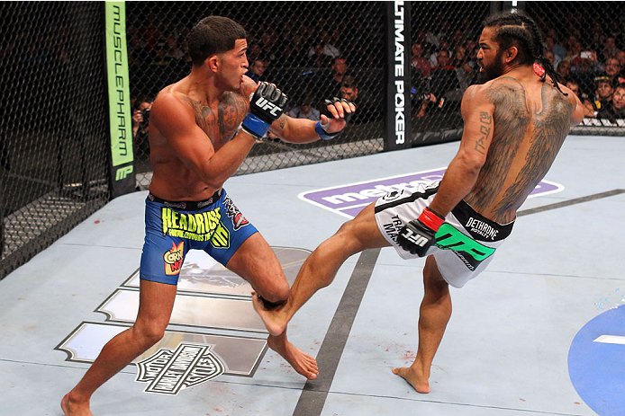 MILWAUKEE, WI - AUGUST 31:  (R-L) Benson Henderson kicks Anthony Pettis in their UFC lightweight championship bout at BMO Harris Bradley Center on August 31, 2013 in Milwaukee, Wisconsin. (Photo by Ed Mulholland/Zuffa LLC/Zuffa LLC via Getty Images) *** Local Caption *** Benson Henderson; Anthony Pettis