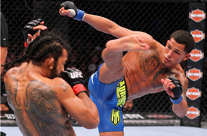 MILWAUKEE, WI - AUGUST 31:  (R-L) Anthony Pettis kicks Benson Henderson in their UFC lightweight championship bout at BMO Harris Bradley Center on August 31, 2013 in Milwaukee, Wisconsin. (Photo by Ed Mulholland/Zuffa LLC/Zuffa LLC via Getty Images) *** Local Caption *** Benson Henderson; Anthony Pettis