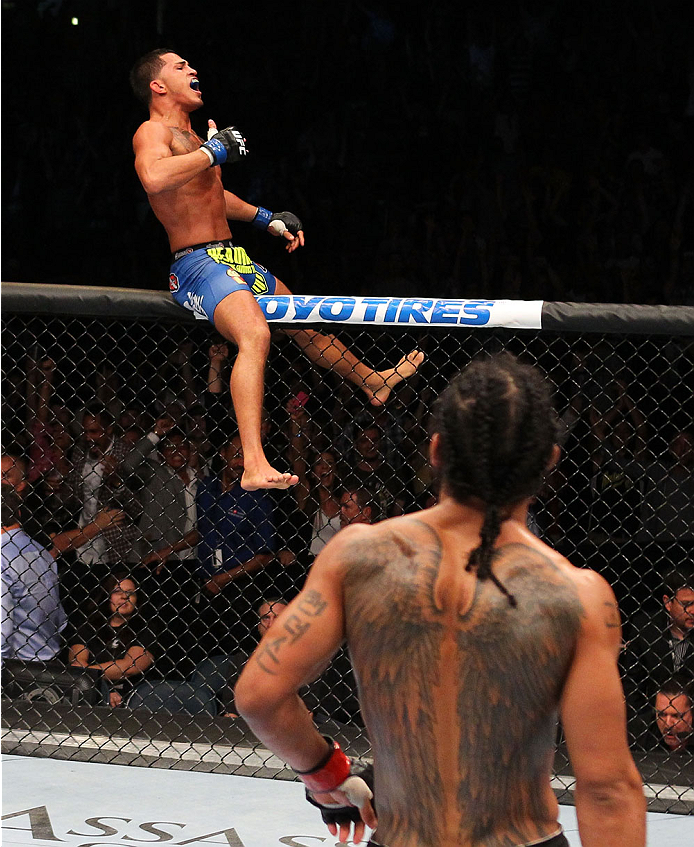 MILWAUKEE, WI - AUGUST 31:  (L-R) Anthony Pettis celebrates after defeating Benson Henderson in their UFC lightweight championship bout at BMO Harris Bradley Center on August 31, 2013 in Milwaukee, Wisconsin. (Photo by Ed Mulholland/Zuffa LLC/Zuffa LLC via Getty Images) *** Local Caption *** Benson Henderson; Anthony Pettis