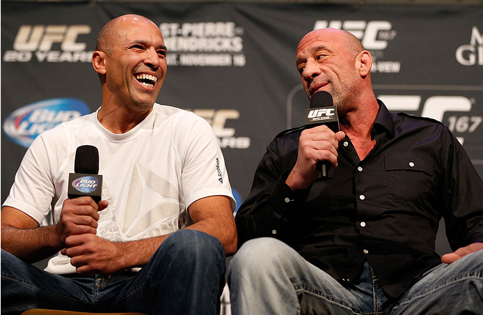 LAS VEGAS, NV - NOVEMBER 15:  (L-R) UFC legends Royce Gracie and Mark Coleman interact with fans during a Q&A session before the UFC 167 weigh-in inside the MGM Grand Garden Arena on November 15, 2013 in Las Vegas, Nevada. (Photo by Josh Hedges/Zuffa LLC/Zuffa LLC via Getty Images)