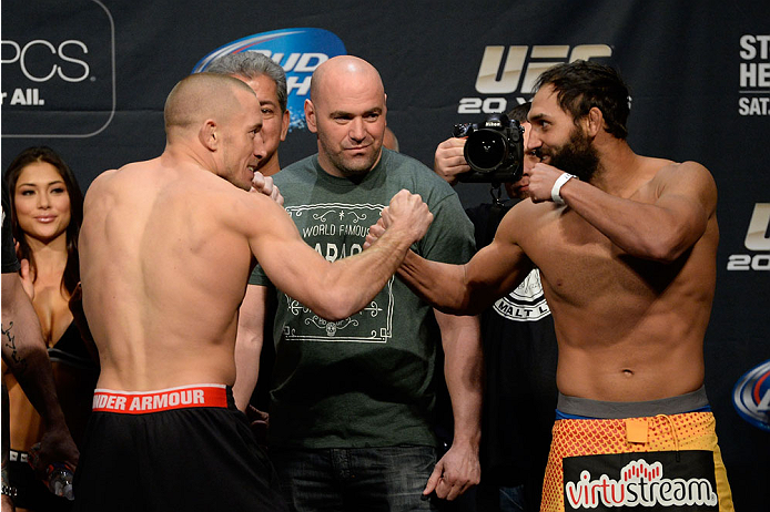 LAS VEGAS, NEVADA - NOVEMBER 15:  (L-R) Georges St-Pierre and Johny Hendricks face off during the UFC 167 weigh-in event at the MGM Grand Garden Arena on November 15, 2013 in Las Vegas, Nevada. (Photo by Jeff Bottari/Zuffa LLC/Zuffa LLC via Getty Images)