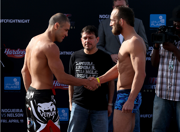 ABU DHABI, UNITED ARAB EMIRATES - APRIL 10:  Thales Leites shakes hands with Trevor Smith after they weigh-in for UFC Fight Night 39 on April 10, 2014 in Abu Dhabi, United Arab Emirates. UFC Fight Night 39 will take place on April 11 at du Arena featuring Antonio Rodrigo Nogueira and Roy Nelson.  (Photo by Warren Little/Zuffa LLC/Zuffa LLC via Getty Images)