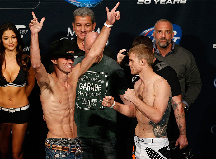 "LAS VEGAS, NV - NOVEMBER 15:  (L-R) Opponents Donald ""Cowboy"" Cerrone and Evan Dunham face off during the UFC 167 weigh-in inside the MGM Grand Garden Arena on November 15, 2013 in Las Vegas, Nevada. (Photo by Josh Hedges/Zuffa LLC/Zuffa LLC via Getty Images)"